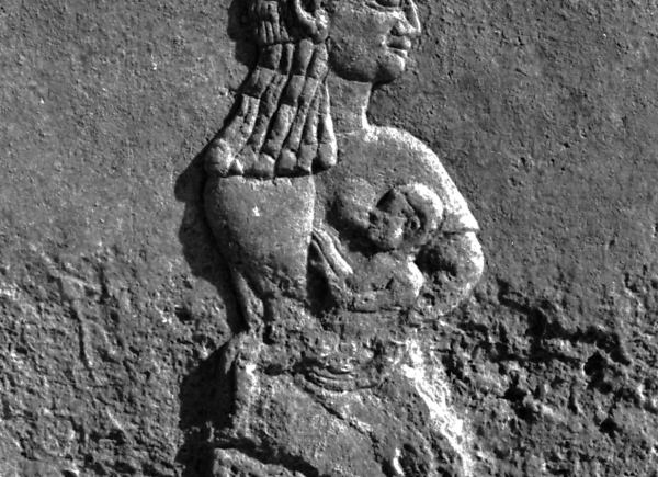 Mother feeding a baby; detail of relief with the scene of looting of a conquered city.