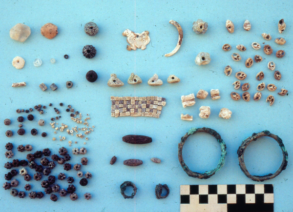 Collection of adornments from one of the burials, including bronze bracelets and zoomorphic pendants (four-legged animal and four ducks); second half of the 3rd millennium BC (Photo Andrzej Reiche)