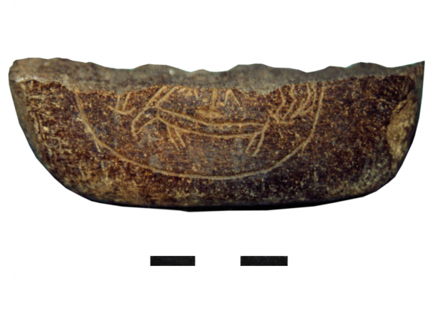 Straightener with zoomorphic decoration, chlorite. (Photo R.F. Mazurowski)